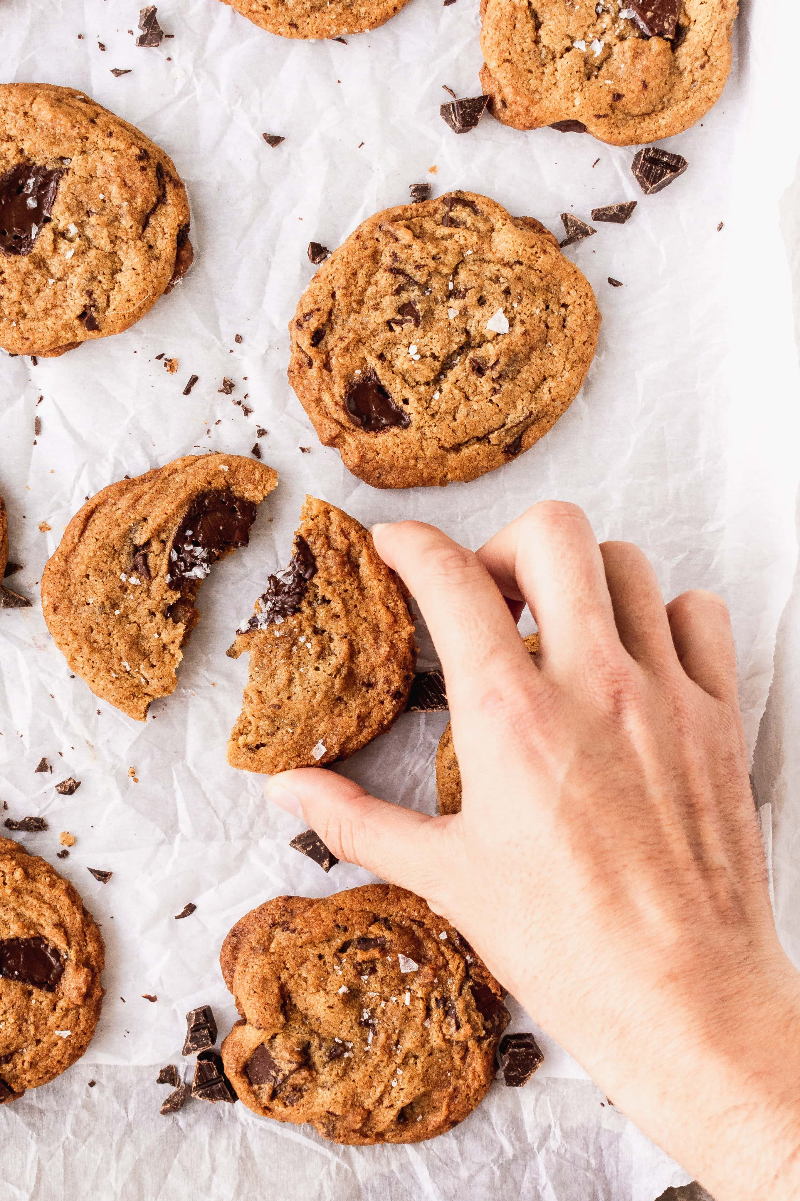 Chewy Vegan Chocolate Chip Cookies - reaching in | The Hangry Chickpea