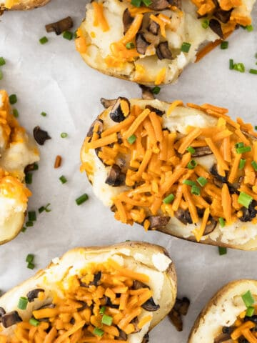 Vegan twice baked potatoes with cheese, mushrooms, and scallions