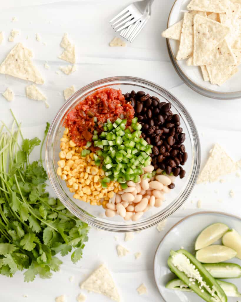 Black bean salsa with street corn plus white beans and jalapenos, a and a twist of lime.