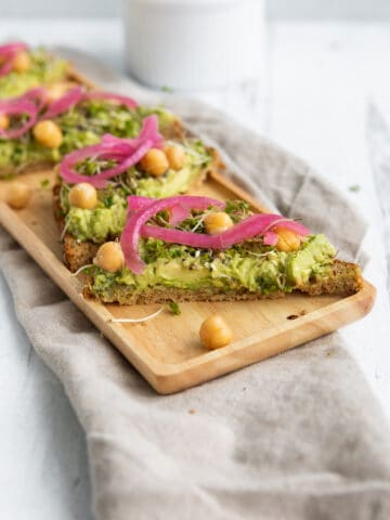 Avocado toast with pickled red onion, chickpeas and sprouts