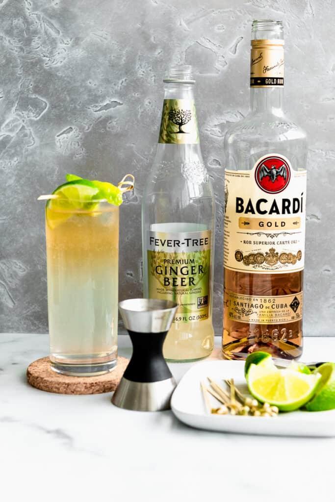 dark n stormy ish ingredients - rum, ginger beer, ice, and lime wedges.