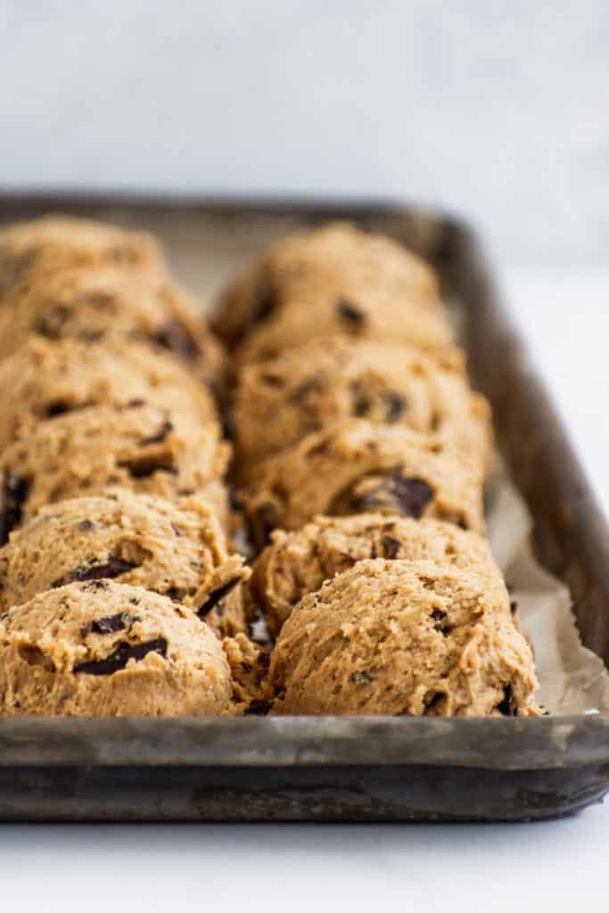vegan chocolate chunk cookie dough balls on a baking sheet